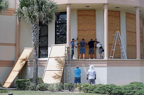 PHOTO: Workers cover stained glass windows with plywood sections at the Santa Maria del Mar Catholic Church in preparation for Hurricane Dorian, Aug. 30, 2019, in Flagler Beach, Fla. (John Raoux/AP)