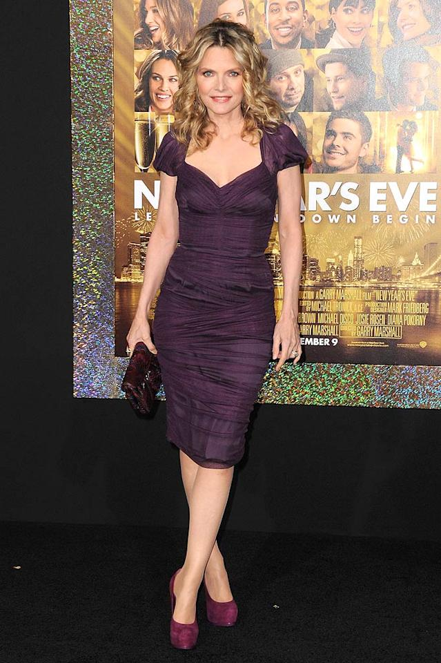 "Michelle Pfeiffer also wowed on the ""New Year's Eve"" red carpet in a stunning purple Dolce & Gabbana dress, ""Tribtoo"" pumps by Yves Saint Laurent, and a snakeskin clutch. If we could all only look this good at age 53! (12/05/2011)"