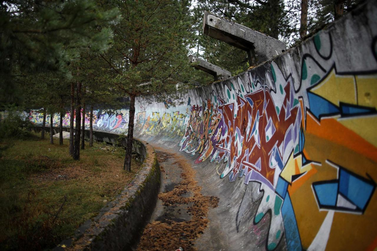 REFILE CORRECTING TYPO IN SARAJEVO   The disused bobsleigh track from the Sarajevo 1984 Winter Olympics is seen on Mount Trebevic, near Sarajevo September 19, 2013. Abandoned and left to crumble into oblivion, most of the 1984 Winter Olympic venues in Bosnia's capital Sarajevo have been reduced to rubble by neglect as much as the 1990s conflict that tore apart the former Yugoslavia. The bobsleigh and luge track at Mount Trebevic, the Mount Igman ski jumping course and accompanying objects are now decomposing into obscurity. The bobsleigh and luge track, which was also used for World Cup competitions after the Olympics, became a Bosnian-Serb artillery stronghold during the war and is nowadays a target of frequent vandalism. The clock is now ticking towards the 2014 Winter Olympics, with October 29 marking 100 days to the opening of the Games in the Russian city of Sochi. Picture taken on September 19, 2013. REUTERS/Dado Ruvic (BOSNIA AND HERZEGOVINA - Tags: SPORT BOBSLEIGH SOCIETY OLYMPICS TPX IMAGES OF THE DAY)  ATTENTION EDITORS: PICTURE 10 OF 23 FOR PACKAGE 'SARAJEVO'S WINTER OLYMPIC LEGACY'. TO FIND ALL IMAGES SEARCH 'DADO IGMAN'