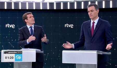 Candidates for Spanish general elections People's Party (PP) Pablo Casado and Prime Minister and Socialist Workers' Party (PSOE) Pedro Sanchez attend a televised debate ahead of general elections in Pozuelo de Alarcon, outside Madrid, Spain, April 22, 2019. TVE via REUTERS