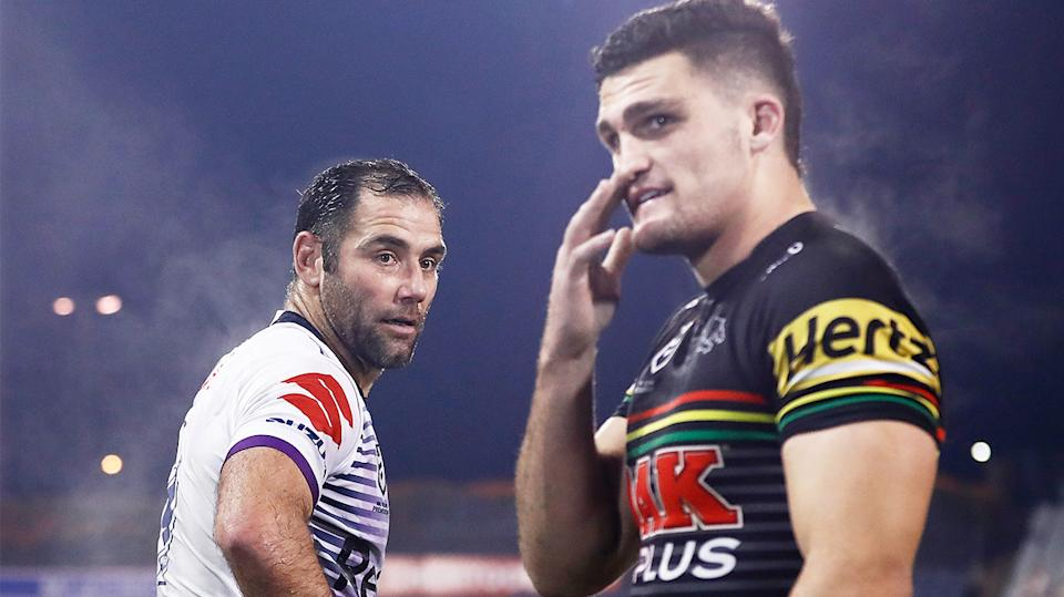 Cameron Smith (pictured left) looking back at Nathan Cleary (pictured right).