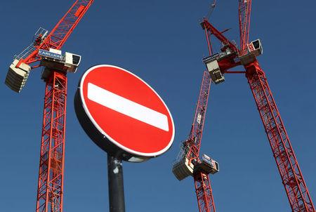 FILE PHOTO: Cranes stand on a Carillion construction site in central London