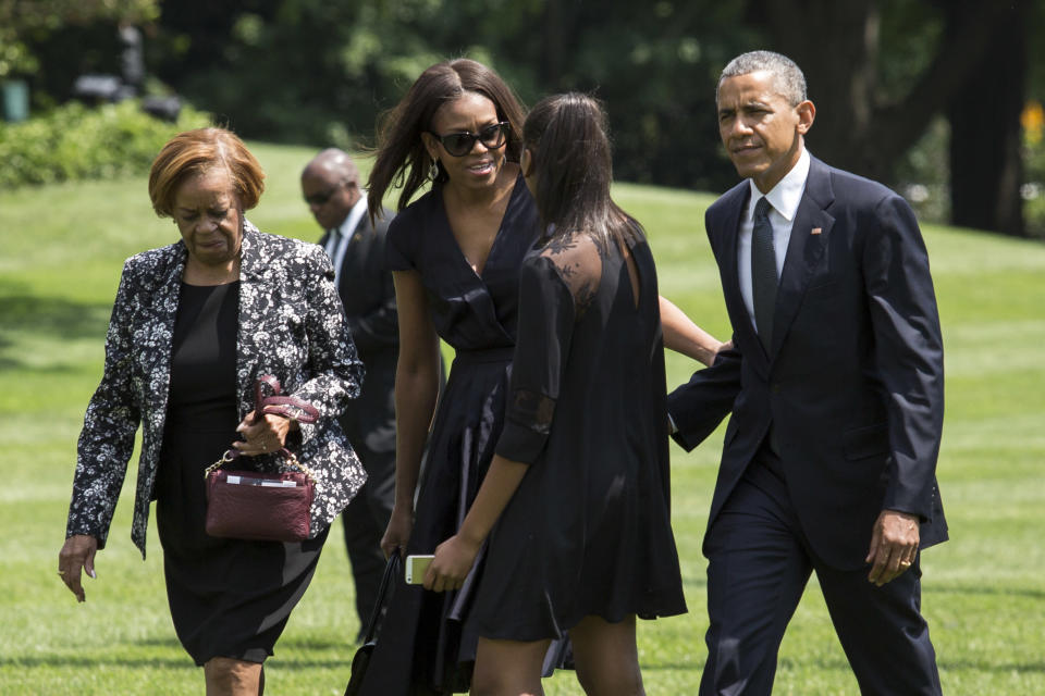 Marian Robinson (left) with the Obamas. (Photo: Drew Angerer/Bloomberg)