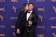 <p>Clearly proud as punch after Legend earns an Emmy, making him one of the few people in the world - and the first black man - to have an EGOT status (Emmy, Grammy, Oscar and Tony award), Teigen kisses her husband in the press room.</p>