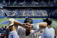 Tennis fans watch play between Karolina Pliskova, of the Czech Republic, and Catherine McNally, of the United States, during the first round of the US Open tennis championships, Tuesday, Aug. 31, 2021, in New York. (AP Photo/John Minchillo)