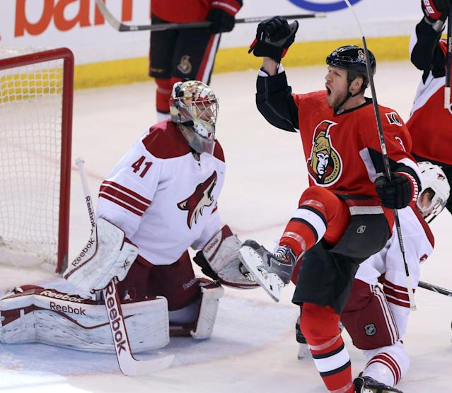 Ottawa Senators' Marc Methot (3) celebrates his goal as Phoenix Coyotes goaltender Mike Smith (41) watches during the first period of an NHL hockey game Saturday, Dec. 21, 2013, in Ottawa, Ontario. (AP Photo/The Canadian Press, Fred Chartrand)