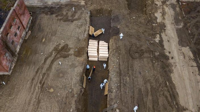 About 40 coffins were buried on Thursday