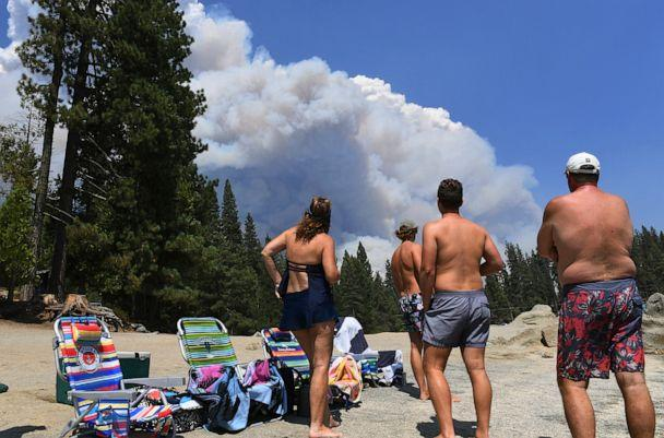 PHOTO: A family from Ventura County watches the billowing smoke from the Creek Fire from the shore of Shaver Lake, northeast of Fresno, California, on Sept. 5, 2020. (Eric Paul Zamora/The Fresno Bee via AP)