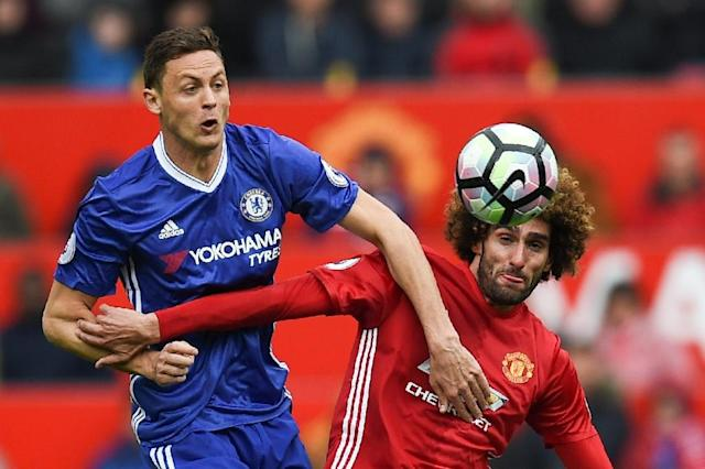 Nemanja Matic (left) in action against Manchester United at Old Trafford on April 16, 2017 (AFP Photo/Oli SCARFF )