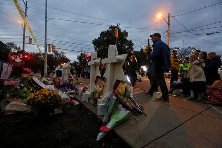 People pay their respects at a makeshift memorial outside the Tree of Life synagogue following Saturday's shooting at the synagogue in Pittsburgh