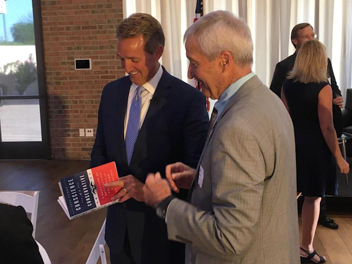 """Jeff Flake signs a copy of his """"Conscience of a Conservative"""" at a Chamber of Commerce breakfast in Gilbert, Ariz. (Photo: Andrew Romano/Yahoo News)"""