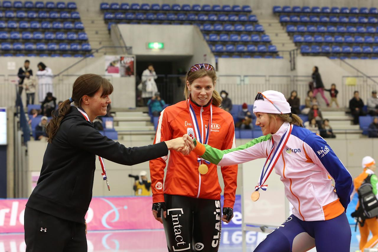 NAGANO, JAPAN - DECEMBER 09: (L-R) Heather Richardson of USA for second place, Christine Nesbitt of Canada for first place, Lotte van Beek of Netherlands for third place celebrate on the podium after the Women's 1000m during day two of the ISU World Cup Speed Skating at MWave on December 9, 2012 in Nagano, Japan. (Photo by Ken Ishii/Getty Images)
