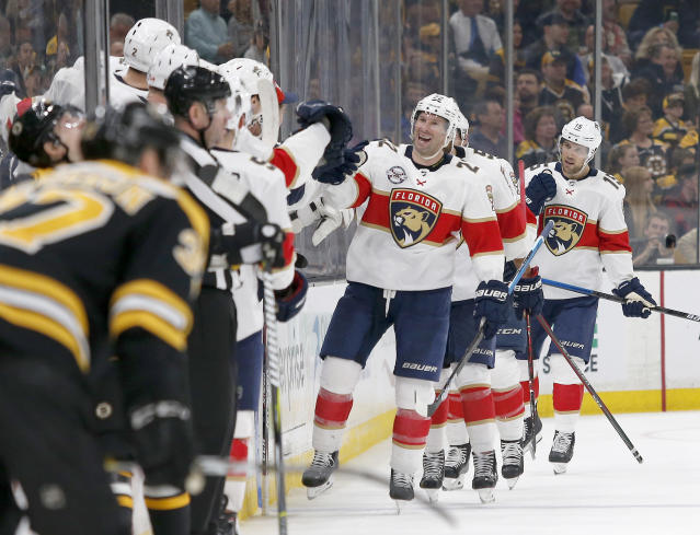 Florida Panthers right wing Troy Brouwer (22) is congratulated at the bench after scoring during a Boston Bruins power play during the second period of an NHL hockey game, Saturday, March 30, 2019, in Boston. (AP Photo/Mary Schwalm)