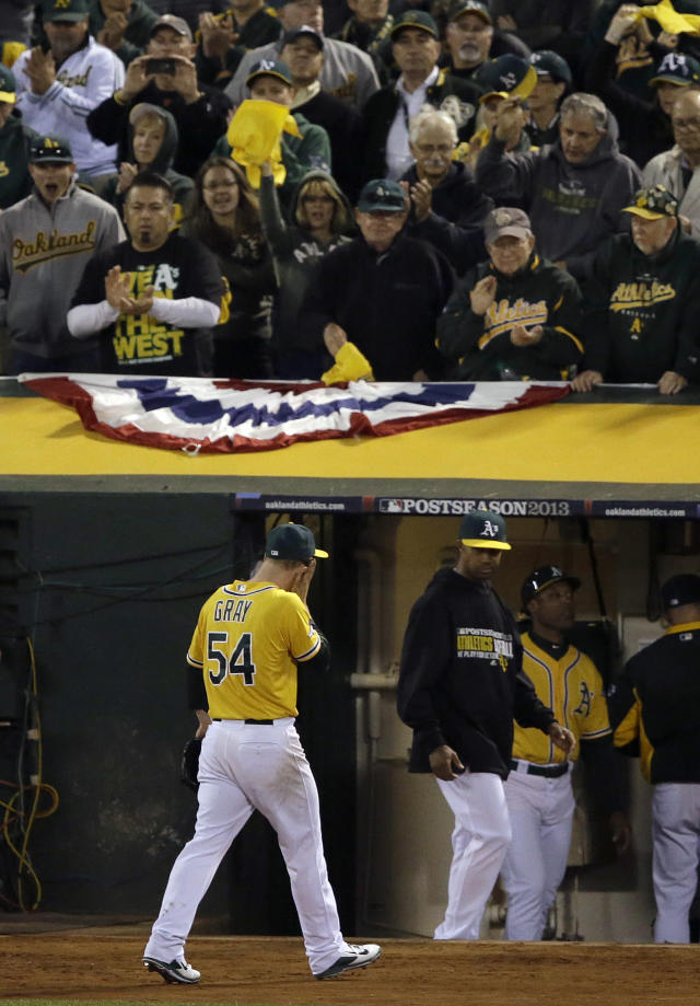 Oakland Athletics pitcher Sonny Gray (54) walks to the dugout after being relieved during the sixth inning of Game 5 of an American League baseball division series against the Detroit Tigers in Oakland, Calif., Thursday, Oct. 10, 2013. (AP Photo/Jeff Chiu)