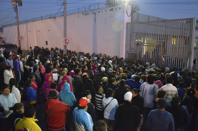FILE - In this Feb. 11, 2016 file photo, relatives of inmates stand outside the Topo Chico prison, where a riot broke out overnight in Monterrey, Mexico. Gov. Jaime Rodríguez announced Monday, Sept. 30, 2019, that the Mexican border state of Nuevo Leon has closed the notorious prison and will be replaced by a park and state archives. (AP Photo/Emilio Vazquez, File)