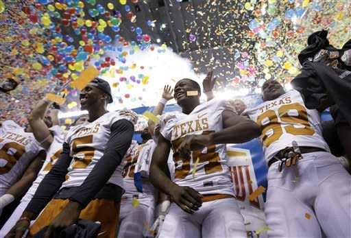 Texas' Marquise Goodwin, center, celebrates with teammates after defeating Oregon State in the Alamo Bowl NCAA football game, Saturday, Dec. 29, 2012, in San Antonio. Texas won 31-27. (AP Photo/Eric Gay)