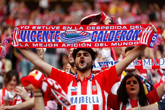 Soccer Football - Europa League Final - Atletico Madrid fans watch the final - Olympique de Marseille vs Atletico Madrid - Wanda Metropolitano, Madrid, Spain - May 16, 2018 Atletico Madrid fan holds up a scarf REUTERS/Juan Medina