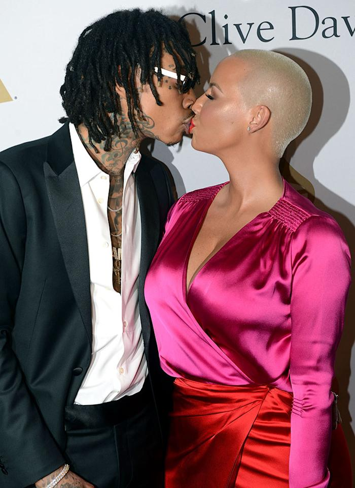 "<p>Divorced couple Wiz Khalifa and Amber Rose seemed to confirm that they are on again as they passionately kissed for the photographers and were incredibly affectionate inside the show. <a rel=""nofollow"" href=""https://www.yahoo.com/celebrity/amber-rose-val-chmerkovskiy-break-190006417.html"">Poor Val Chmerkovskiy!</a> (Photo: Scott Dudelson/Getty Images) </p>"