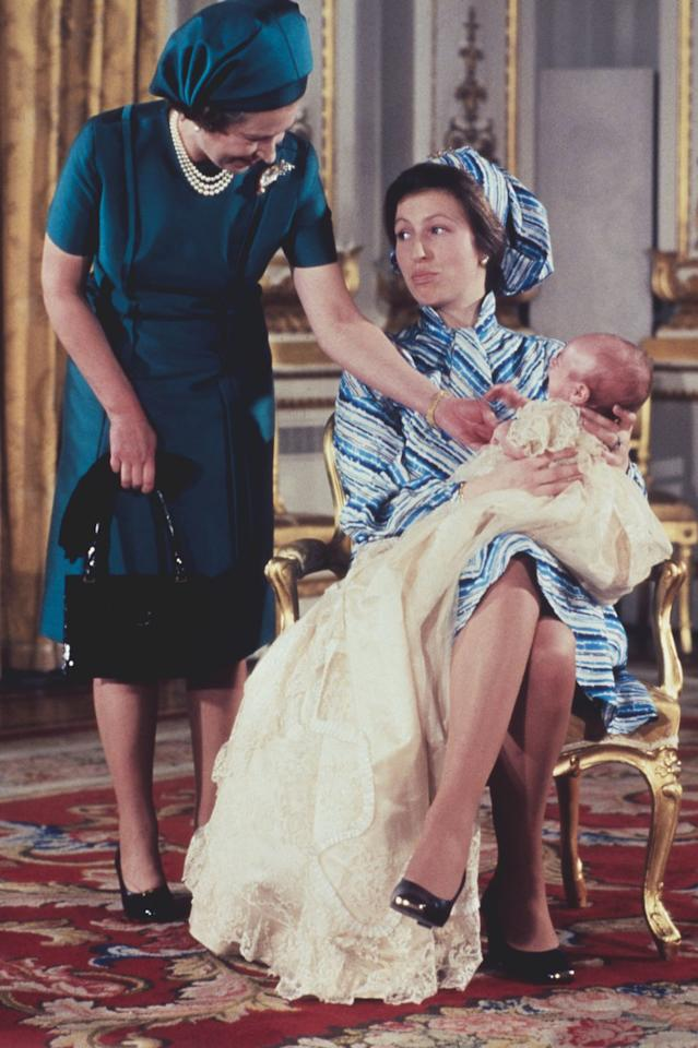 """<p>The best part of this picture from Peter Phillips's 1977 christening is Princess Anne's face, which clearly says """"Mom, cool it."""" Obviously the Queen couldn't help it though; he was her first grandchild!</p>"""