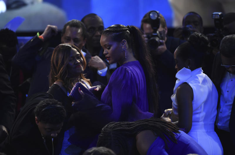Rihanna stands in the audience at the 51st NAACP Image Awards at the Pasadena Civic Auditorium on Saturday, Feb. 22, 2020, in Pasadena, Calif. (AP Photo/Chris Pizzello)