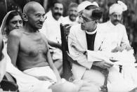 Mahatma Gandhi talks to Reverend A. M. Dalaya, the Principal of King Edward's College in Peshawar. Gandhi has come to talk to the students at the college. (Photo by © Hulton-Deutsch Collection/CORBIS/Corbis via Getty Images)