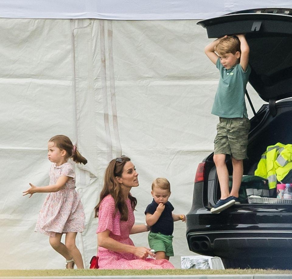 <p>The dynamic changes when kids outnumber adults. Prince George plays in the car trunk at the King Power Royal Charity Polo Day at Billingbear Polo Club. </p>