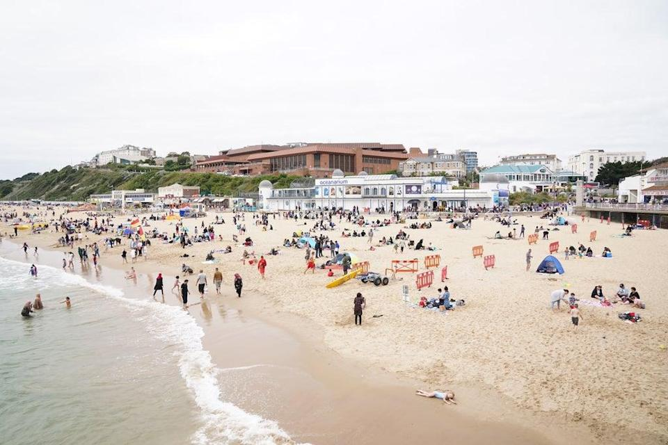People enjoying the Bank Holiday weather on Bournemouth beach. Picture date: Monday August 30, 2021. (PA Wire)