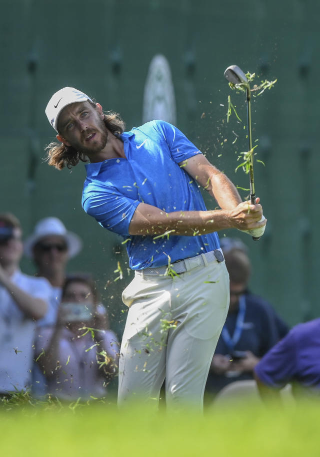 England's Tommy Fleetwood plays a shot on his way to win the the 39th edition of the Nedbank Golf Challenge, at Sun City, South Africa, Sunday, Nov. 17 2019. Fleetwood made three eagles and came from six shots behind going into the final round to win the Nedbank Golf Challenge in a playoff against Marcus Kinhult on Sunday. (AP Photo/Christiaan Kotze)