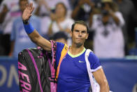 Rafael Nadal, of Spain, waves to the fans as he leaves the court after he lost to Lloyd Harris, of South Africa, at the Citi Open tennis tournament Thursday, Aug. 5, 2021, in Washington. Harris won 6-4, 1-6, 6-4. (AP Photo/Nick Wass)