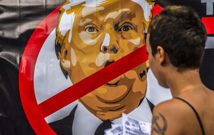 <p>A banner protesting U.S. President Donald Trump is on Avenida Paulista during a demonstration, Jan. 20, 2017, in Sao Paulo, Brazil. (Photo: Cris Faga/LatinContent/Getty Images) </p>