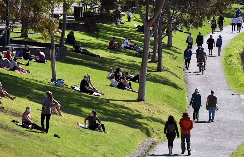 Melburnians soak up the sun over the weekend as the city's cases continue to drop. Source: Getty