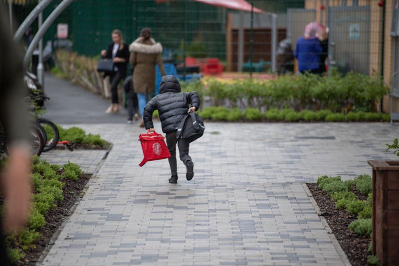 A child arriving at Moorside Community Primary School in the morning