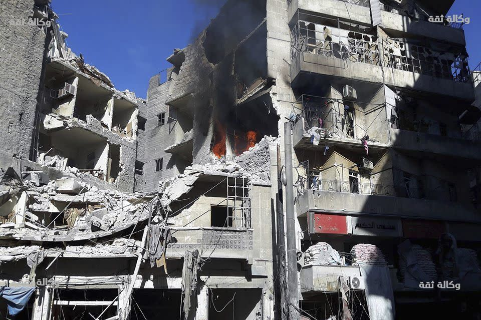 <p>Smoke rises and fires still burn after airstrikes hit the Al-Shaar neighborhood of Aleppo, Syria, Friday, Nov. 18, 2016. (Thiqa News via AP) </p>