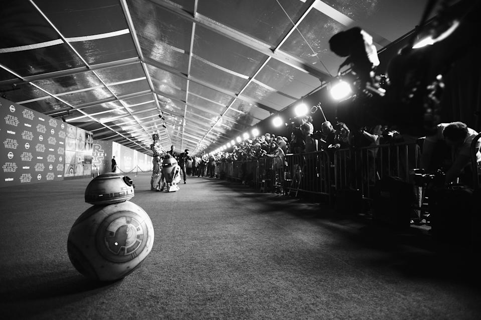 BB-8 prepares to roll down the carpet behind fellow droids C-3PO and R2-D2. (Photo: Charley Gallay/Getty Images for for Disney)