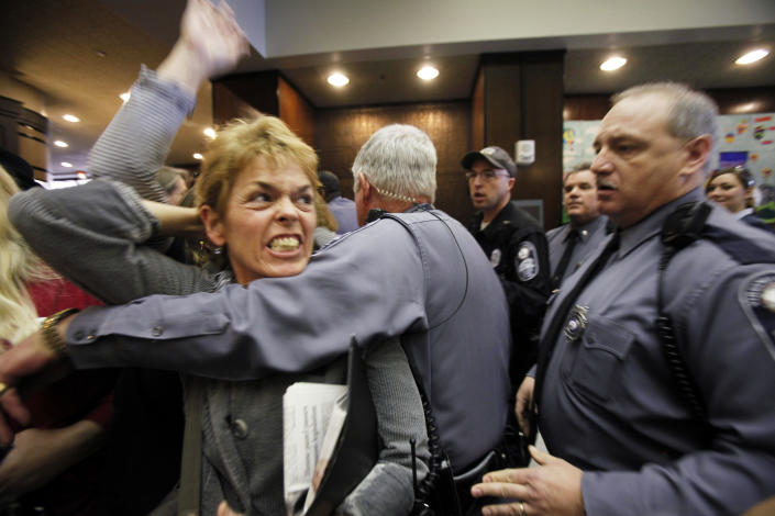 Pro-choice advocate Margaret Doyle from Richmond, Va., is removed by Capitol Police from the General Assembly Building in Richmond after HB1, the bill that states human life begins at conception, passed the Senate Education and Health committee on Thursday, Feb. 23, 2012. Eight Republicans voted for the measure, and the committee's seven Democrats opposed it after an hour-long hearing on the bill that is similar to one in Missouri. The vote now sends the bill to the full Senate where Democrats and Republicans hold 20 seats apiece. (AP Photo/Richmond Times-Dispatch, Bob Brown)