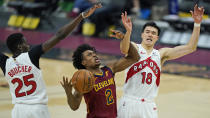 Cleveland Cavaliers' Collin Sexton (2) drives between Toronto Raptors' Yuta Watanabe (18) and Chris Boucher (25) in the first half of an NBA basketball game, Saturday, April 10, 2021, in Cleveland. (AP Photo/Tony Dejak)