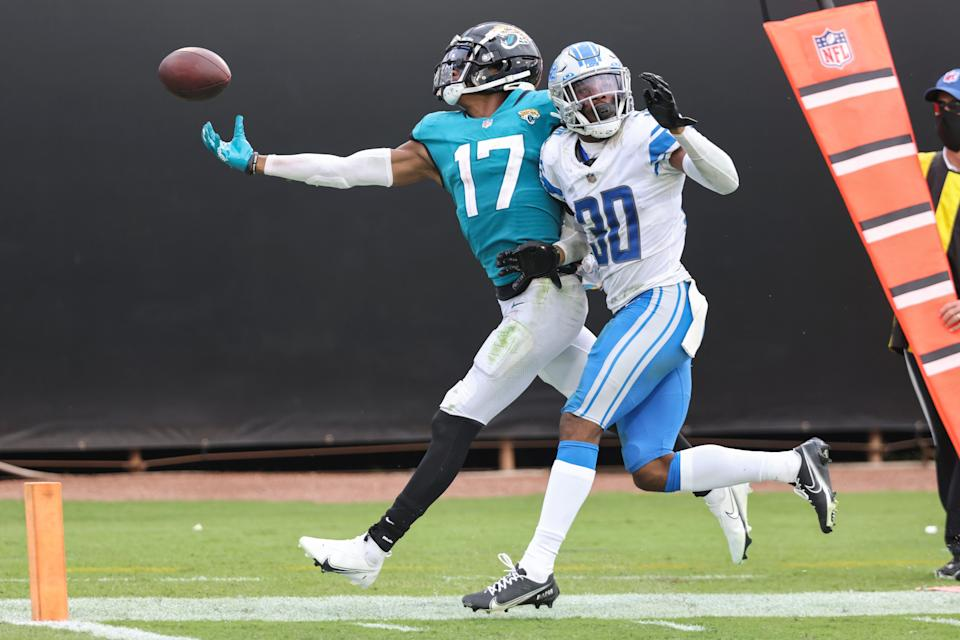 Jacksonville Jaguars' D.J. Chark attempts to catch a pass while defended by Detroit Lions' Jeff Okudah during the fourth quarter at TIAA Bank Field on Oct. 18, 2020 in Jacksonville, Fla.