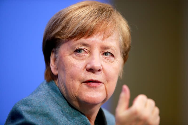 FILE PHOTO: FILE PHOTO: German Chancellor Merkel holds a news conference in Berlin
