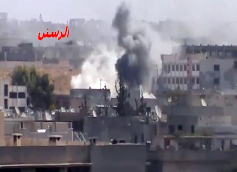 In this image taken from video obtained Friday, Sept. 21, 2012 from the Shaam News Network, SNN, which has been authenticated based on its contents and other AP reporting, shows shelling of Rastan in Homs province, Syria, Friday, Sept. 21, 2012. (AP Photo/Shaam News Network, via AP video)