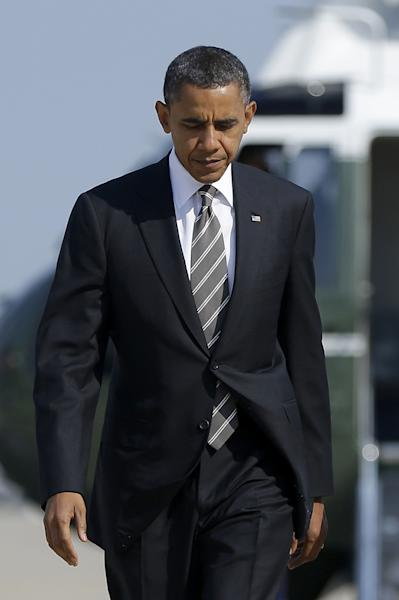 President Barack Obama walks across the tarmac to board Air Force One before his departure from Andrews Air Force Base, Md., Wednesday, Sept., 26, 2012. Obama is traveling to Ohio for a day of campaign event. (AP Photo/Pablo Martinez Monsivais)