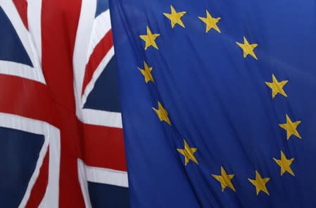 A Union flag flies next to the flag of the European Union in London