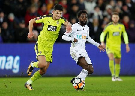 Soccer Football - FA Cup Fourth Round Replay - Swansea City vs Notts County - Liberty Stadium, Swansea, Britain - February 6, 2018 Notts County's Noor Husin in action with Swansea City's Nathan Dyer Action Images via Reuters/Matthew Childs
