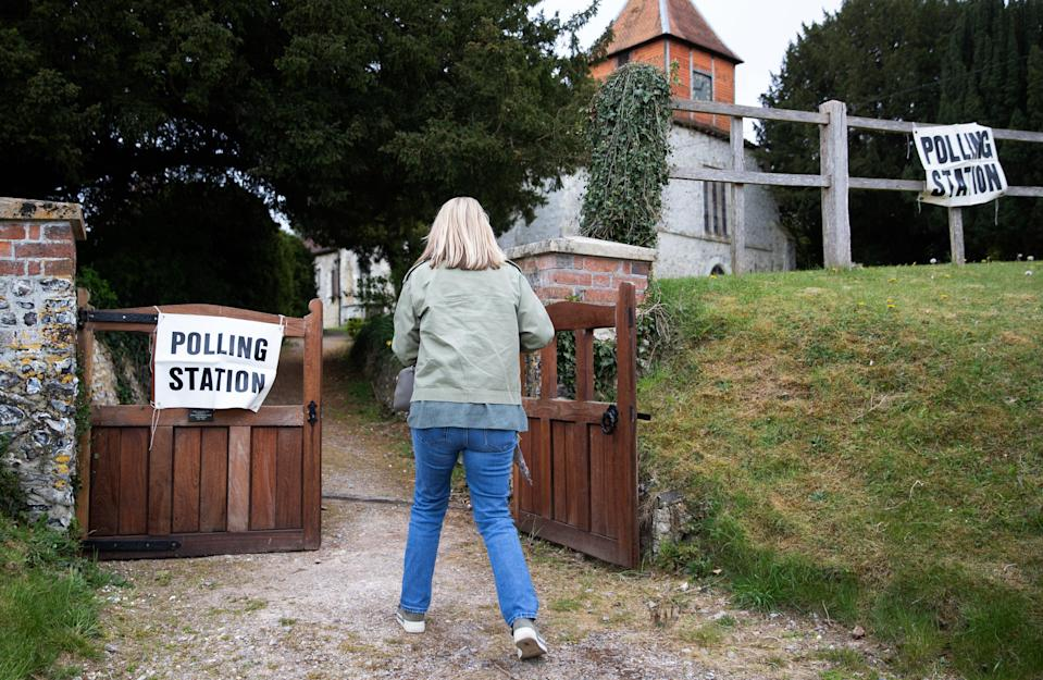 Woman at polling station (PA Wire)