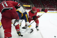 Carolina Hurricanes center Vincent Trocheck (16) and center Jordan Staal (11) struggle with Nashville Predators defenseman Mattias Ekholm during the second period of an NHL hockey game in Raleigh, N.C., Saturday, April 17, 2021. (AP Photo/Gerry Broome)