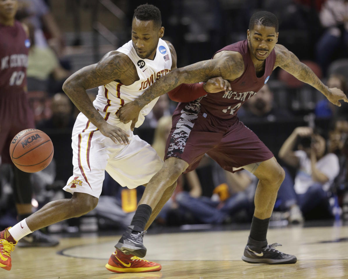 Iowa State guard DeAndre Kane (50) and North Carolina Central guard Jeremy Ingram (14) look for the loose ball during the first half of a second-round game in the NCAA college basketball tournament Friday, March 21, 2014, in San Antonio. (AP Photo/David J. Phillip)