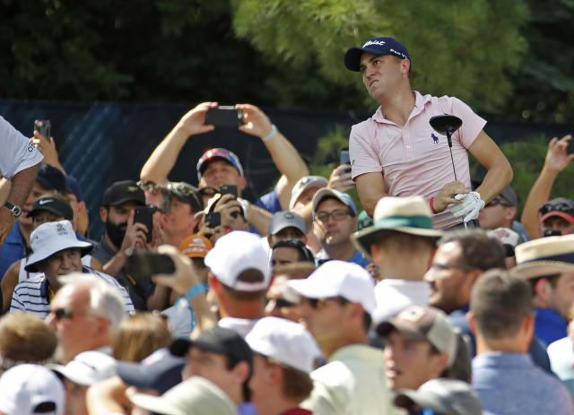 Justin Thomas watches his tee shot on the 15th hole during a practice round for the PGA Championship golf tournament at Bellerive Country Club, Wednesday, Aug. 8, 2018, in St. Louis. (AP Photo/Charlie Riedel)
