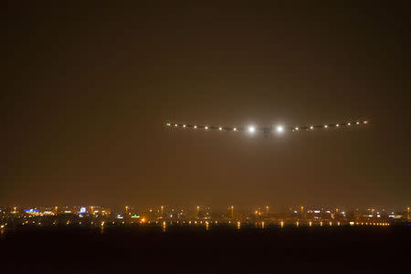 Solar Impulse 2, the world's first airplane flying on solar energy, lands in Ahmedabad March 10, 2015. REUTERS/Jean Revillard/Handout via Reuters