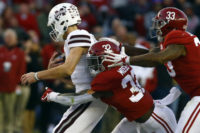 FILE - In this Nov. 10, 2018, file photo, Mississippi State quarterback Nick Fitzgerald (7) is sacked by Alabama linebacker Dylan Moses (32) and linebacker Anfernee Jennings (33) during the second half of an NCAA college football game, in Tuscaloosa, Ala. The hits keep on coming for Alabama's defense in 2019. The latest blow to the second-ranked Crimson Tide defenders was Tuesday's, Aug. 27, 2019, knee injury to star middle linebacker Dylan Moses. (AP Photo/Butch Dill, File)