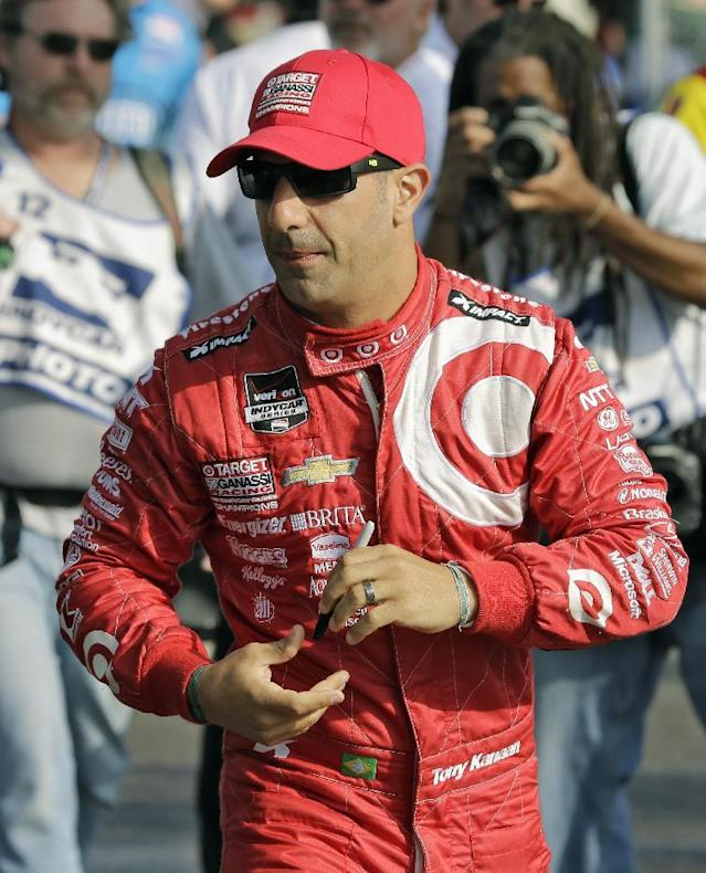 Tony Kanaan, of Brazil, walks to pit road before practice for the IndyCar Firestone Grand Prix of St. Petersburg auto race, Saturday, March 29, 2014, in St. Petersburg, Fla. The race takes place on Sunday. (AP Photo/Chris O'Meara)
