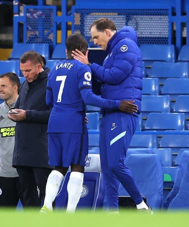 Thomas Tuchel consoles N'Golo Kante, left, as he leaves the field injured
